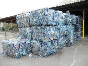 Bales of crushed blue PET bottles