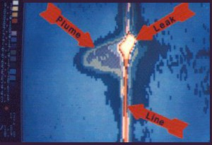 Aerial thermogram of buried cross country oil pipeline revealing subsurface contamination caused by a leak