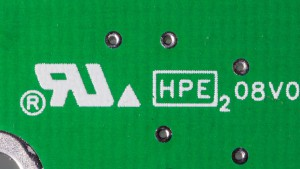 The Recognized Component Mark (left) on a printed circuit board