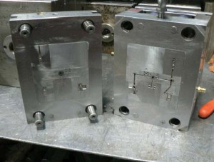 "Standard two plates tooling – core and cavity are inserts in a mould base – ""family mould"" of five different parts"