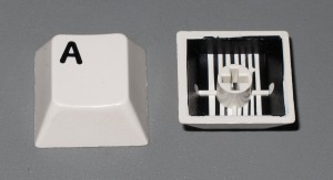 Two-shot injection moulded keycaps from a computer keyboard